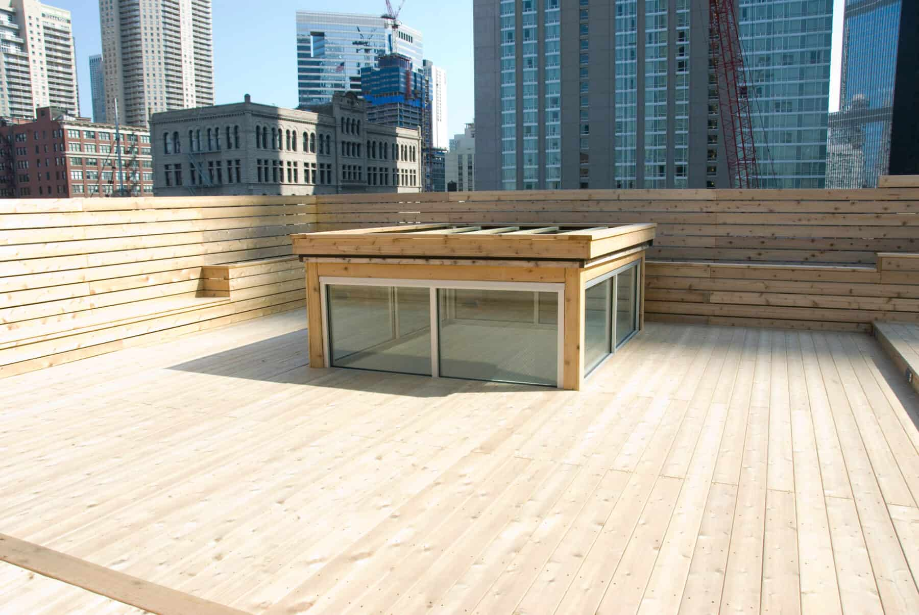Custom Rooftop Deck with Wood Plant boxes, Skylight, Fence and Walkways from Construction Specialty Projects by Commercial Builder & General Contractor Structural Enterprises