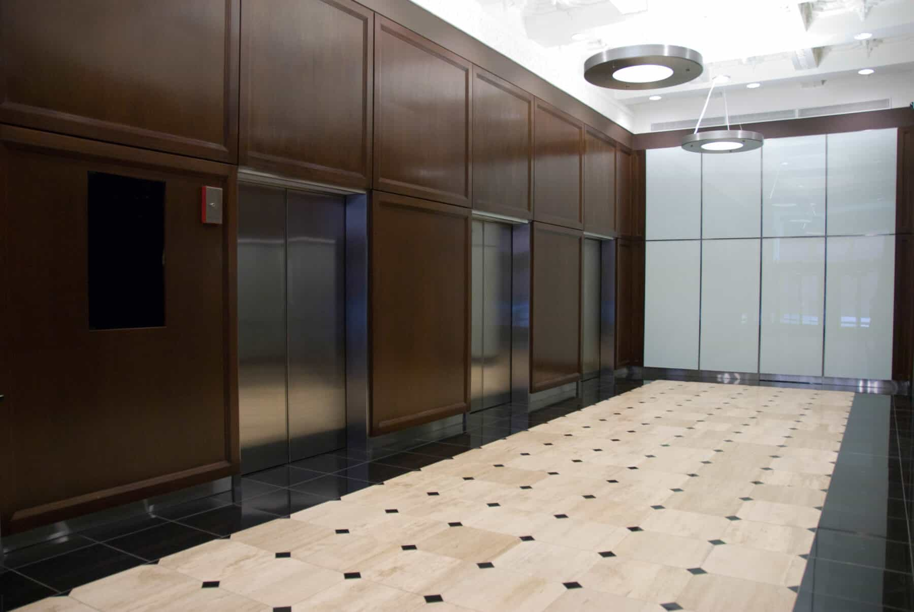 Beautiful Glass Walls and Wood Panels for Adams Street Lobby Remodel by Commercial Builder & General Contractor Structural Enterprises